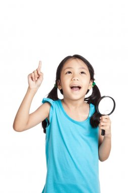 Little asian girl point up with magnifying glass