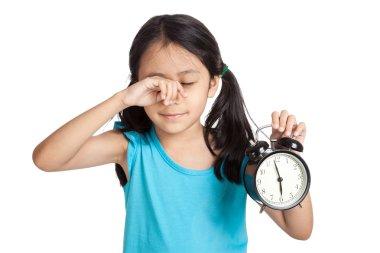 Little asian girl sleepy with a clock