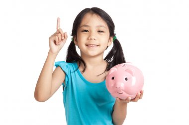 Little asian girl point up with piggy bank