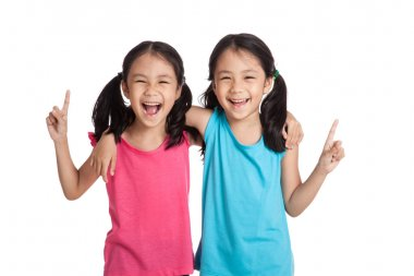 Happy Asian twins girls  smile point up