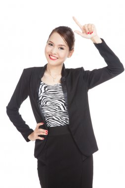 Young Asian businesswoman smile and point up