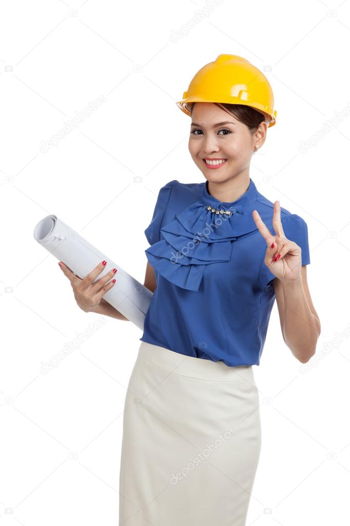 Asian engineer woman with blueprints show victory sign