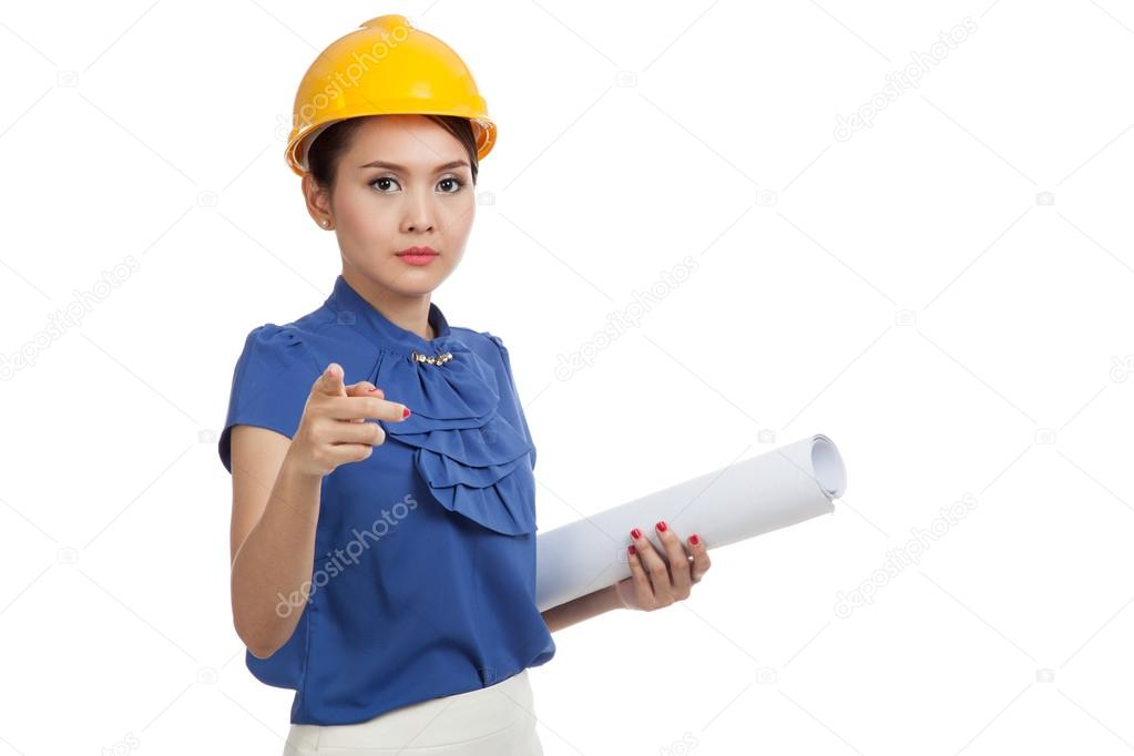 Asian engineer woman pointing with blueprints