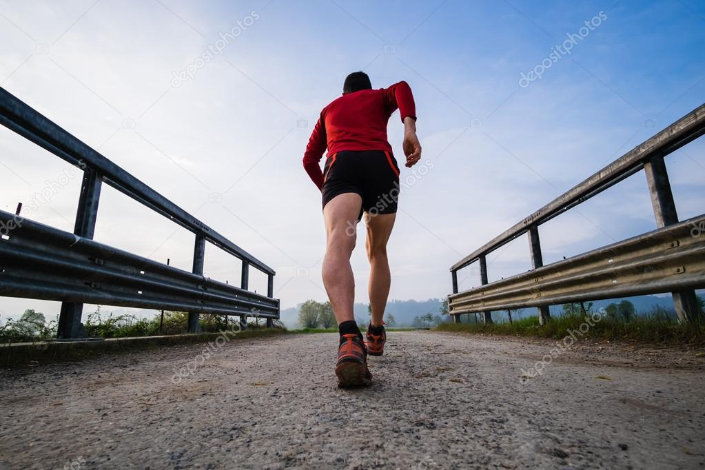 Man running in the country early in the morning