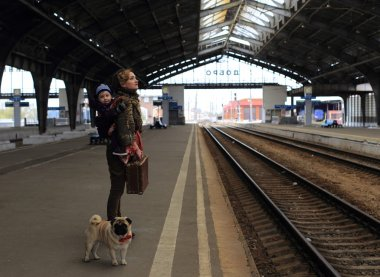 Mom with son and dog travel by train