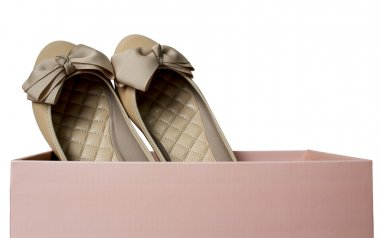 Light brown gloss summer and autumn flat shoes with pink box isolated on white