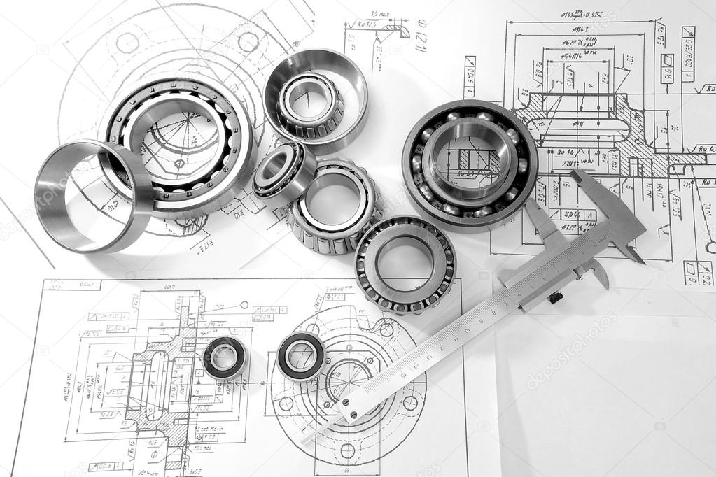 bearings and drawings under a desk lamp