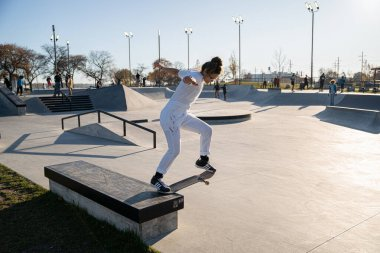 skaters and bikers practice tricks at an outdoor skate park during the pandemic in Detroit, Michigan on November 8, 2020