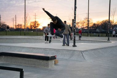 skaters and bikers practice tricks at an outdoor skate park in Detroit, Michigan / USA - November 19 -2020