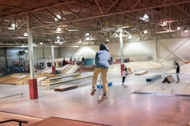 Skaters are practicing their tricks at an indoor skate park in Detroit, Michigan on January 13, 2021