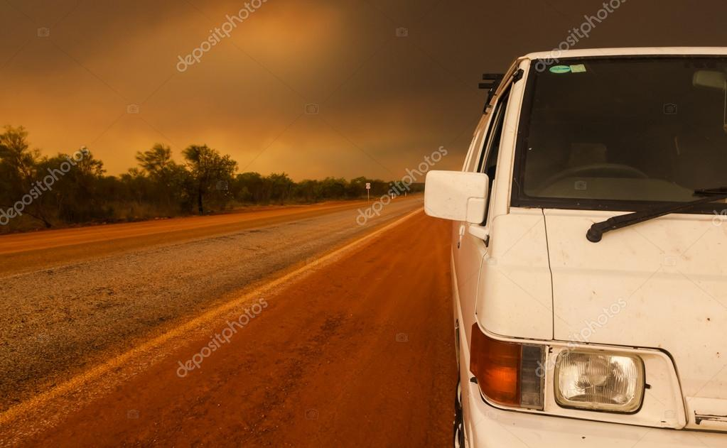 Driving in the outback Australia under a bush fire