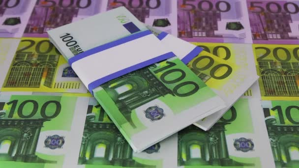 A pack of 500 euros arrives from the side on notes of 100, 200 and 500 euros