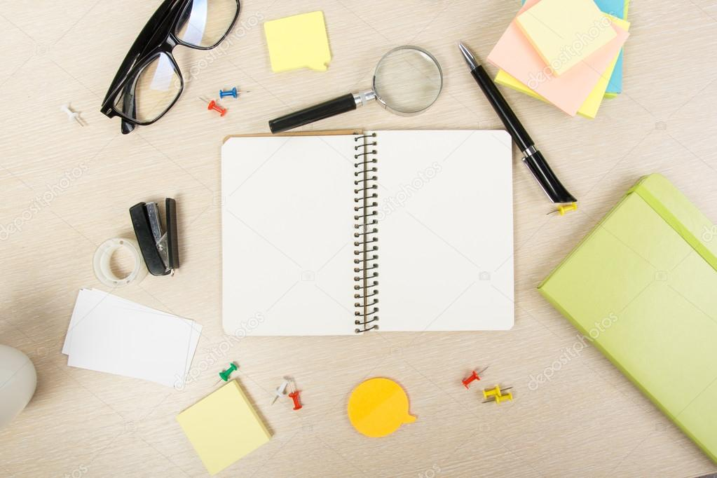White Blank Open Note Book Office Table Desk With Set Of Colorful Supplies Cup Pen Pencils Flower Notes Cards On Beige Background