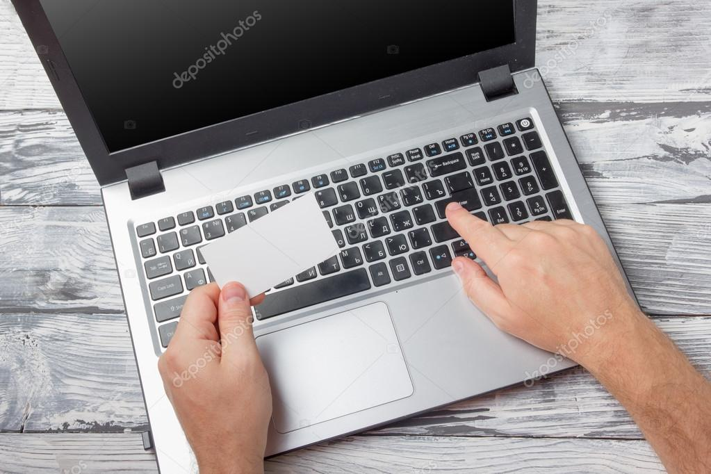 Hands holding business credit card typing numbers laptop computer hands holding business credit card typing numbers laptop computer pc keyboard making online payment at home reheart Images
