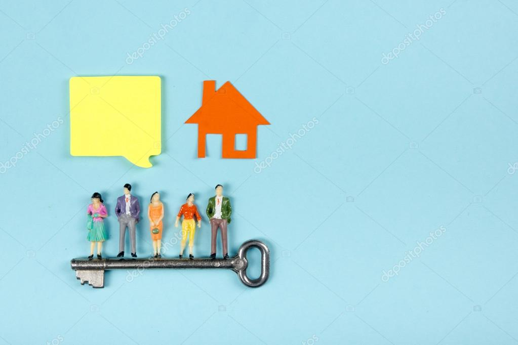 Real estate concept construction building blank speech bubbles real estate concept construction building blank speech bubbles people toy figures paper model house blueprints with key on blue architect desk table malvernweather Image collections