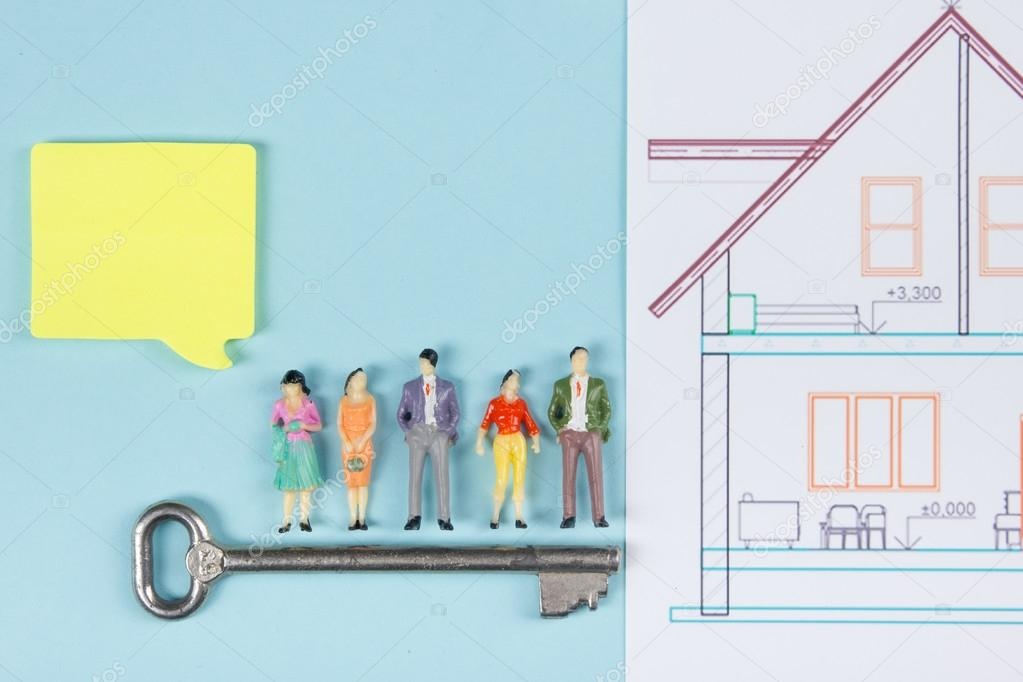 Real estate concept construction building blank speech bubbles blank speech bubbles people toy figures paper model house blueprints with key on blue architect desk table background top view malvernweather Image collections