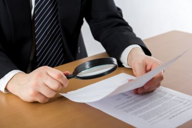 Hands signing business documents. Signing papers. Lawyer