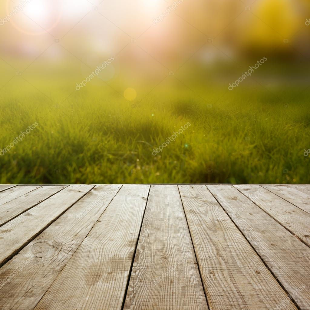 Wooden perspective floor with planks on blurred summer background