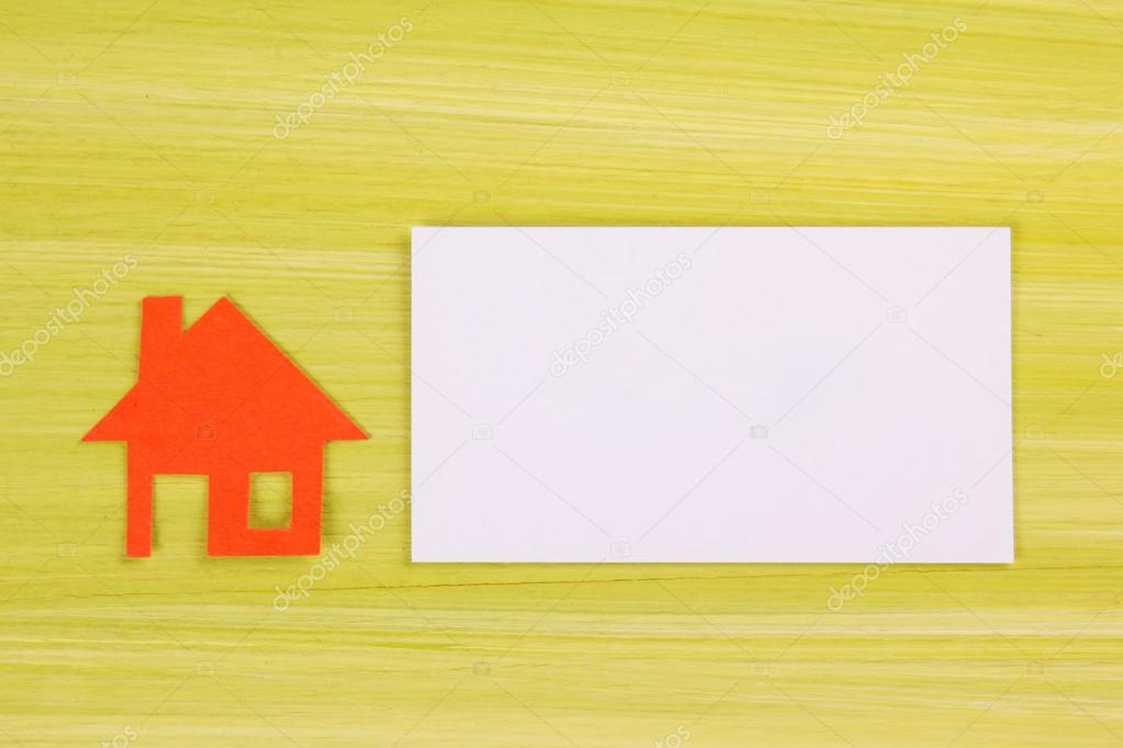 Real Estate Concept. Paper house figure and blank business card ...