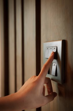 Light switch on wooden blackground.