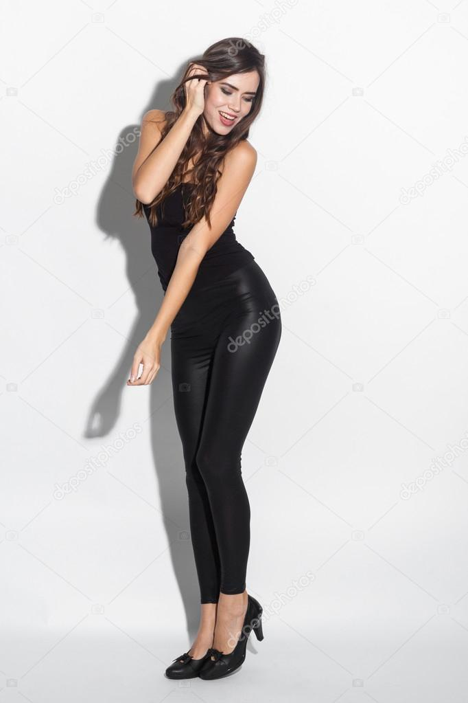 Young Girl On A White Background In A Tight Fitting Dress Black