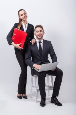 Young creative businesswoman sitting on a chair with a laptop on