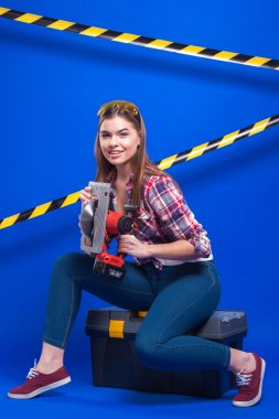 plus-size model on a blue background with the construction of th