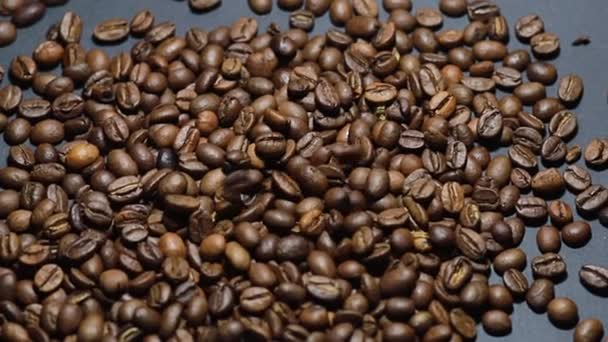 Roasted coffee bean. Fragrant coffee beans scrolls slowly around the camera. Slow Motion Close Up of Whole Roasted Coffee Beans.