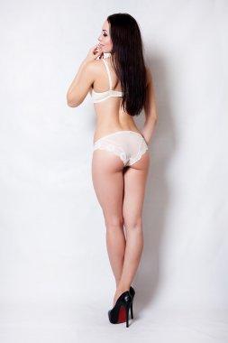 Portrait sexy brunette woman beige underwear