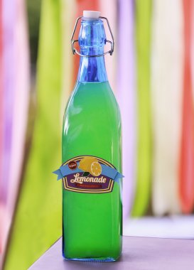 Drink in glass bottle on a vivid background