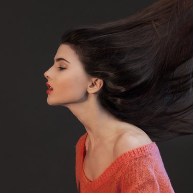 young brunette woman head-shoulders studio shot
