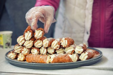 Cannoli pile on the tray
