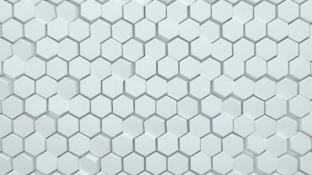 Abstrakter sechseckiger Hintergrund. Eine große Anzahl weißer Sechsecke. 3D-Wandstruktur, sechseckige Blöcke Cluster. Zelluläre Platte. Nahtlose 3D-Animation von 4K