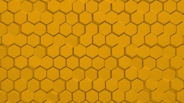 Abstrakter gelber sechseckiger Hintergrund. Eine große Anzahl grüner Sechsecke. 3D-Wandstruktur, sechseckige Blöcke Cluster. Zelluläre Platte. Nahtlose 3D-Animation von 4K