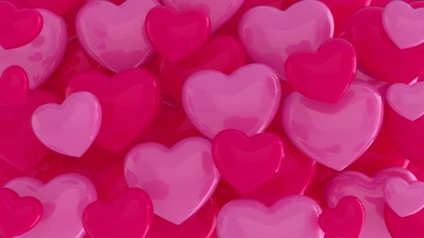 Rózsaszín és vörös szívek, a szerelem szimbóluma. Sok rózsaszín és piros szív repül kaotikusan. Szív háttér. Szerelem, szenvedély, Valentin nap. 3d animációs hurok 4K