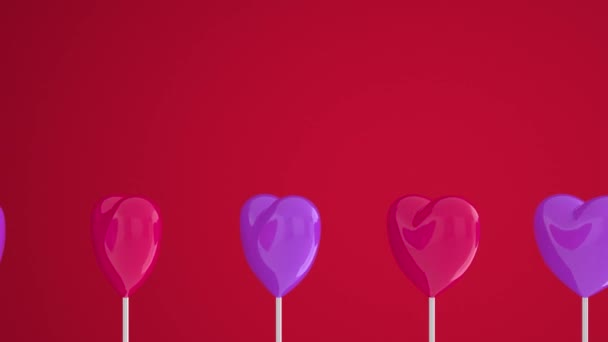 Purple pink hearts on white sticks on red isolated background. Move to the left and rotate. Copy space. Symbols of love, like, Happy Womens, Mothers, Valentines, birthday. 3d animation loop of 4K