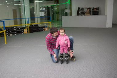 Father learning roller skate  a child