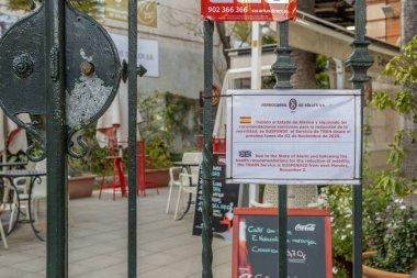 Palma de Mallorca, Spain; april 23 2021: Soller train station located in Palma de Mallorca, closed due to the Coronavirus pandemic. Sign closed as november 2, 2021 in English and Spanish language