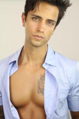 handsome male wearing an open shirt