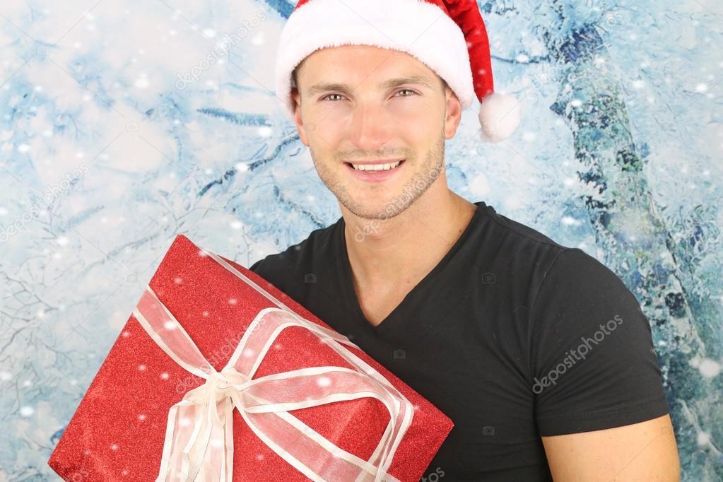 the christmas season - handsome blond man smiling