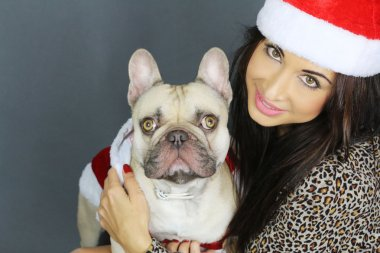 Christmas time - Young woman with a french bulldog