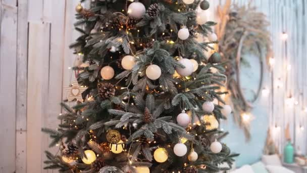 Close to the lights of a living fir tree, decorated with white globes,