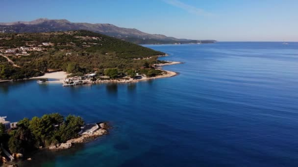 Flying drone over one of the most beautiful beaches of Albania, Ksamil Beach, Albania.