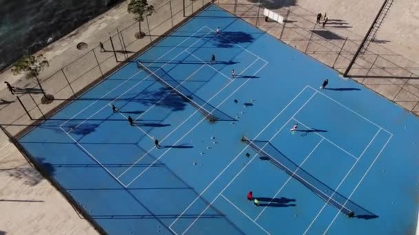 Drone shot of the tennis court in Vlore south of Albania. Kids playing by the beach