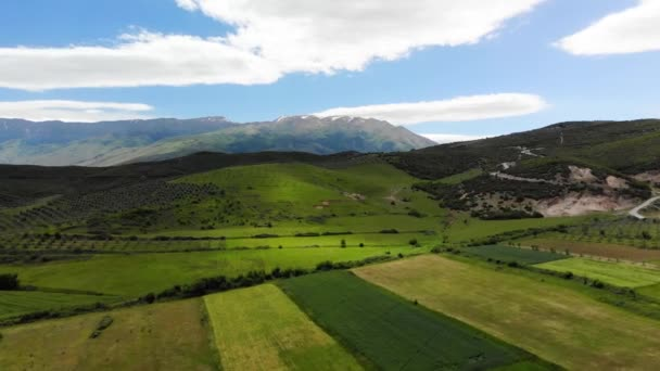 Aerial panoramic view of scenic landscape in the Alps with rugged alpine mountain peaks and lush blooming meadows on a sunny day with beautiful clouds and blue sky in summer. Albania