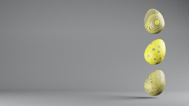 Drei spinnende Ostereier in trendigen Farben, leuchtend und ultimativ grau, kopieren den Raum. Geschlungener 3D-Renderer