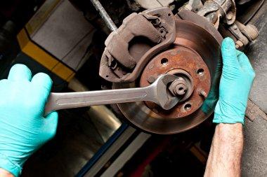 Man repairing a brakes
