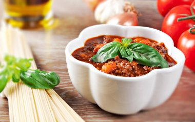 Bolognese sauce on wooden table