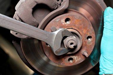 Man repairing car disc brakes