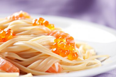 Spaghetti with salmon and caviar